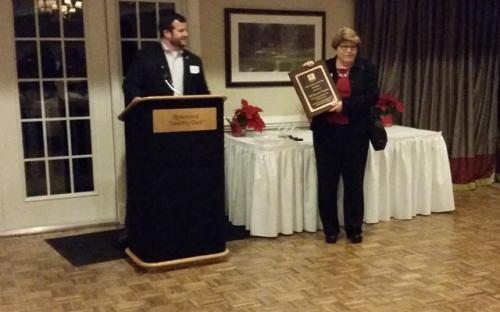 Karen Nuckols accepting Company of the Year on behalf of VML Insurance Programs